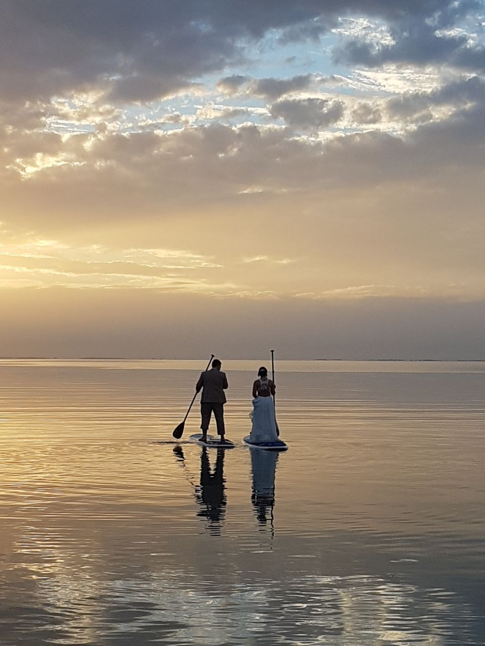 Wedded-Bliss-on-SUPs-at-sunset-St-Georges-Caye-Belize