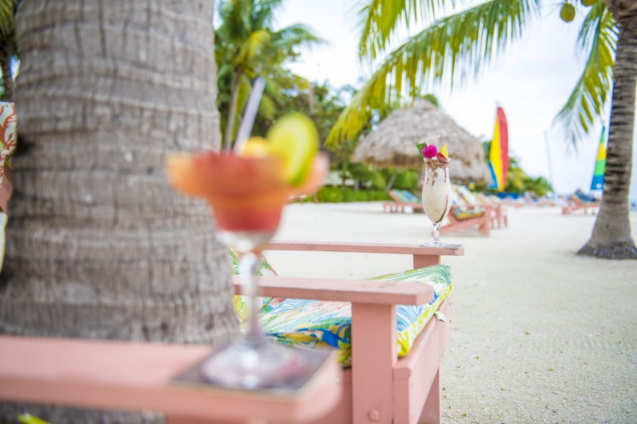 Relax with a tropical drink at St. George's Caye Resort