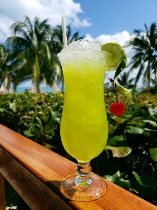 midori illusion cocktail at St. George's Caye Resort Belize