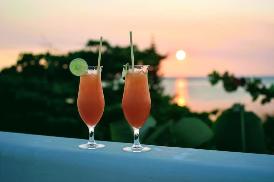 Drinks-overlooking-the-Sea---St.-Georges-Caye-Resort---Belize