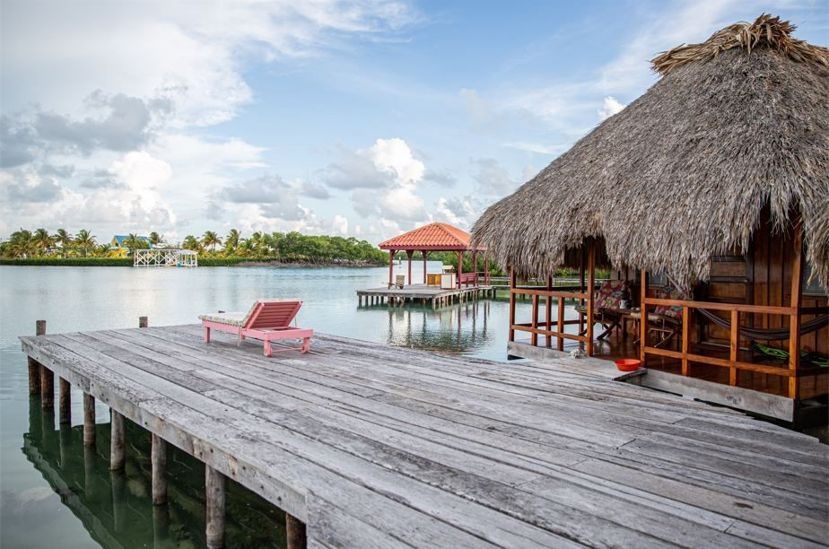 Overwater-Cabana-Thatched-Roof-Bungalows-St.-Georges-Caye-Resort-Belize---Lagoon